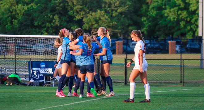 Ole Miss women's soccer player Channing Foster (No. 12) and members of the Ole Miss women's soccer team celebrate during their NCAA Tournament match against the Southern California Trojans in Wilmington, North Carolina, on Friday, April 30, 2021. Ole Miss won the match 3-2 in penalty kicks to advance to the Sweet 16.
