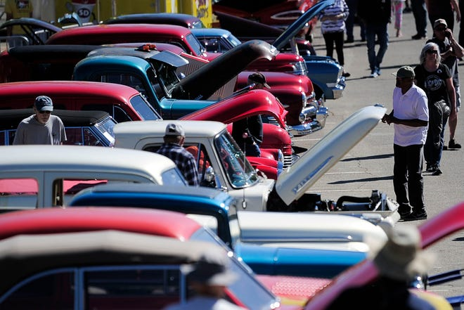 Visitors browse a row of vehicles at the annual Street Rod Nationals South car show at Chilhowee Park in Knoxville, Tenn. on Saturday, May 1, 2021. Iowa Park will be having many fun events this Saturday at ParkFest including a car show and Burnout event.