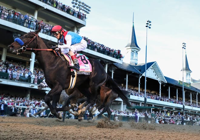John Velazquez, aboard Medina Spirit, wins the Kentucky Derby.