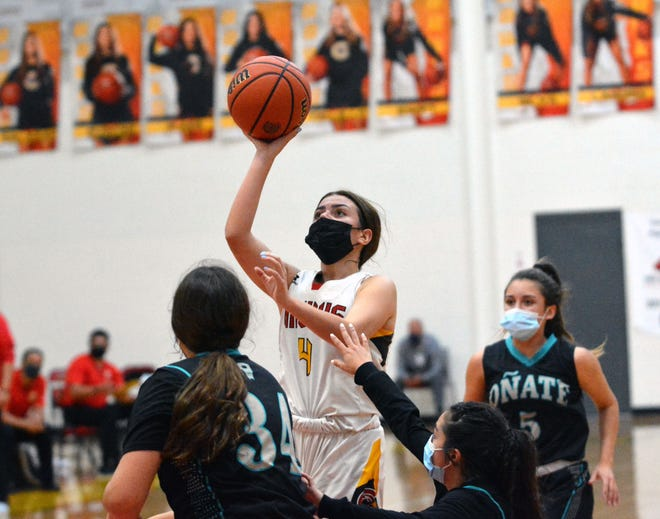 Paetin Silva takes the ball to the hoop as Centennial took on Oñate Tuesday night.