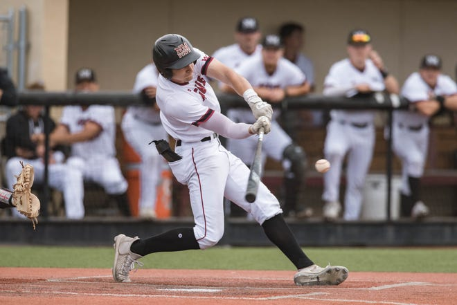Ethan Mann (5) hits a home run as the New Mexico State Aggies face the University of Texas Rio Grande Valley Vaqueros at Presley Askew Field in Las Cruces on Friday, April 30, 2021.
