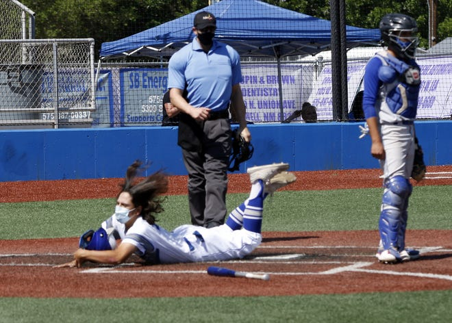 Carlsbad's Tyler Wages safely slides into home plate to score against Las Cruces on May 1, 2021. The Cavemen will host Artesia this Friday with a 5:30 p.m. start time.