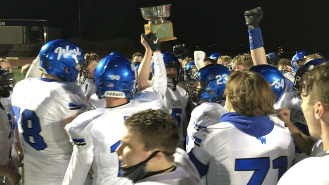 Oshkosh West football hosts the Schumerth Cup after defeating crosstown rival Oshkosh North 49-22 on April 30 at Titan Stadium.