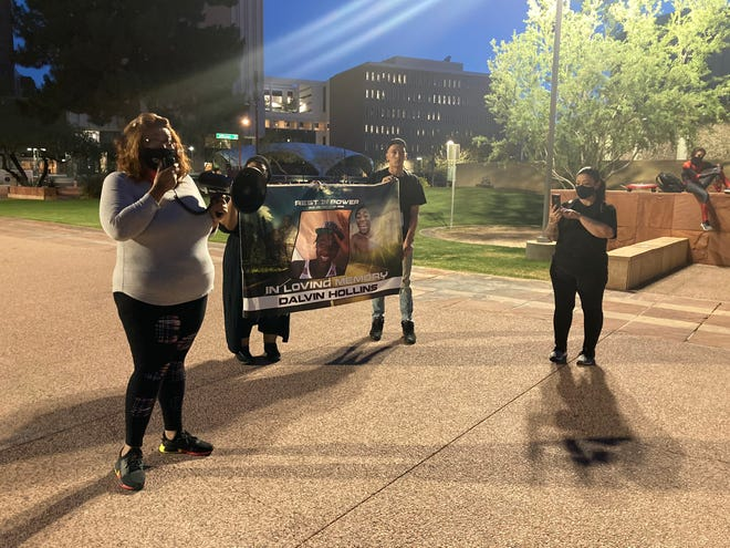 Sarah Coleman, left, the mother of Dalvin Hollins, who was fatally shot by Tempe police in 2016, said she wants more family members of people who were killed by police to come forward at a protest in downtown Phoenix, April 30, 2021.