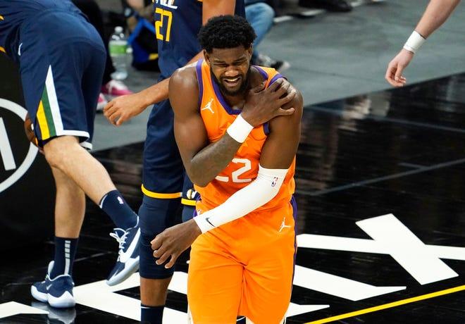 Apr 30, 2021; Phoenix, Arizona, USA; Phoenix Suns center Deandre Ayton (22) reacts after making contact against the Utah Jazz in the first half at Phoenix Suns Arena. Mandatory Credit: Rob Schumacher-Arizona Republic