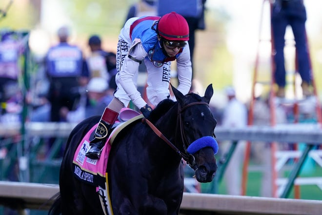 John Velazquez rides Medina Spirit to victory in the 147th running of the Kentucky Derby at Churchill Downs, Saturday, May 1, 2021, in Louisville, Ky. (AP Photo/Michael Conroy)