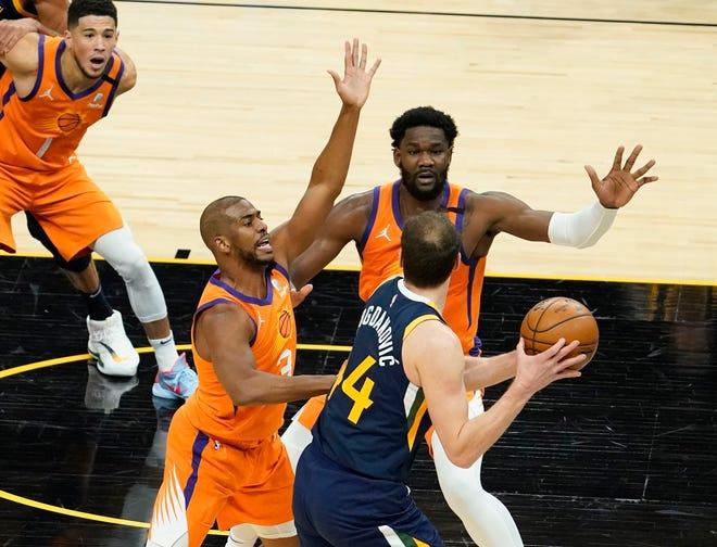 Apr 30, 2021; Phoenix, Arizona, USA; Phoenix Suns guard Chris Paul (3) and center Deandre Ayton (22) pressures Utah Jazz forward Bojan Bogdanovic (44) in the first half at Phoenix Suns Arena. Mandatory Credit: Rob Schumacher-Arizona Republic