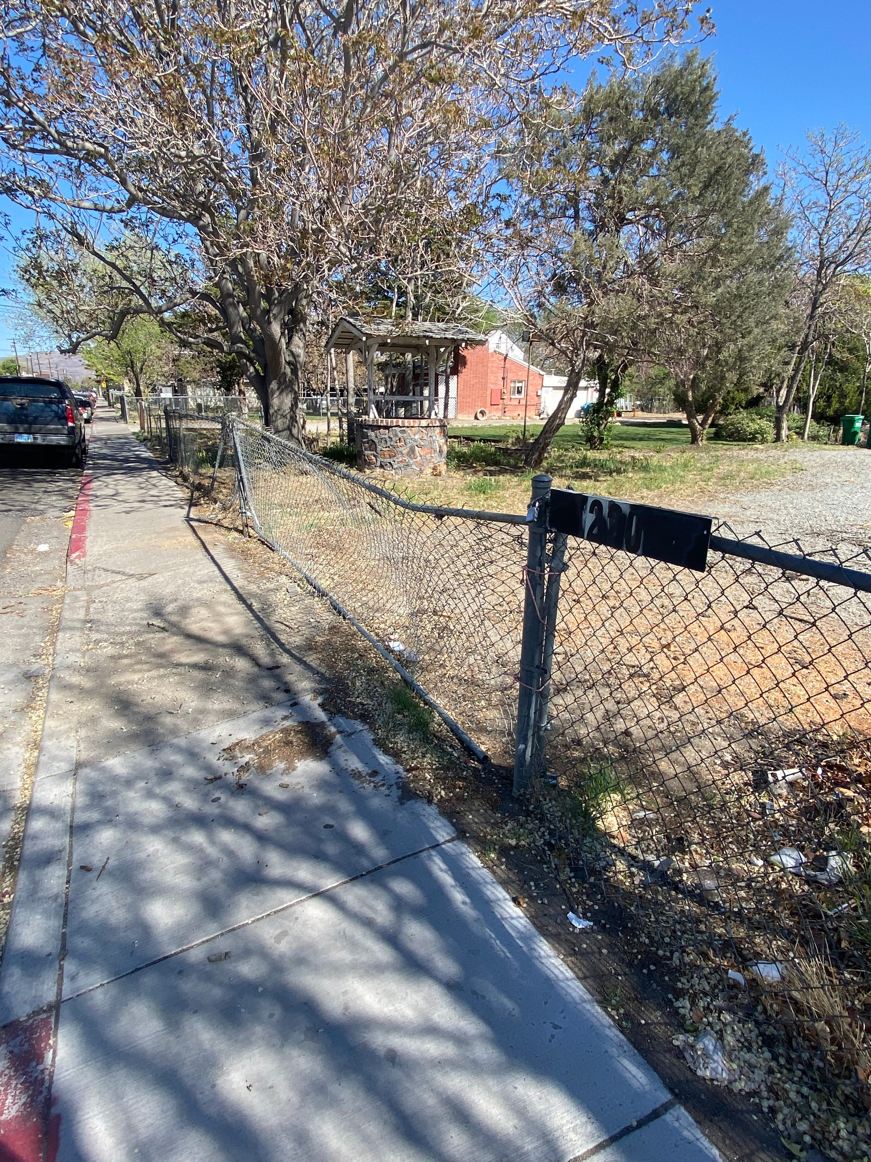 Neighbors in the 200 block of Grove Street say a man crashed into this fence after being fatally shot Friday, April 30. The Washoe County Regional Medical Examiner's Office later identified the man as Marco Avalos Telles, 24.