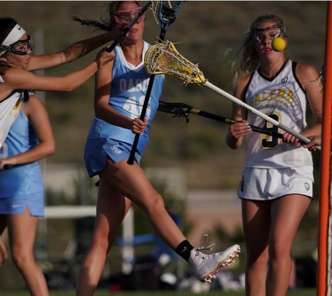 Sadie O'Flaherty, a senior at Oasis, helped the girls lacrosse team beat Galena last week.