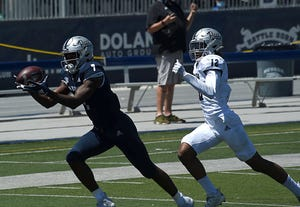 The Wolf Pack's Romeo Doubs, left, is on the initial watch lists for two national awards.