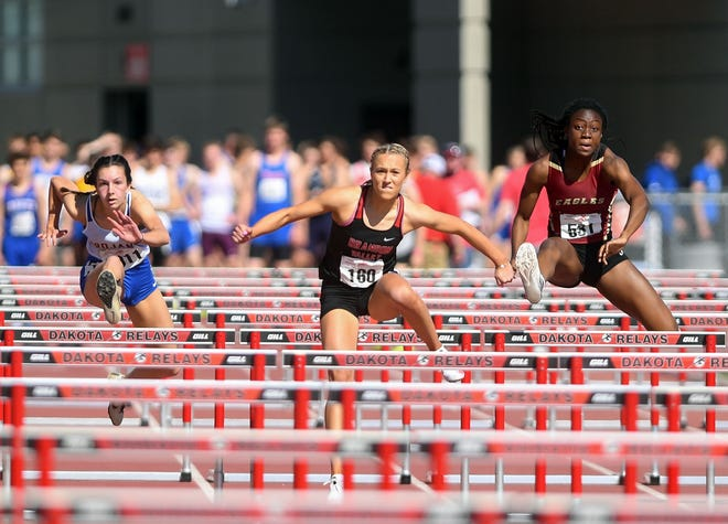 Brandon Valley's Brielle Dixon, center, competes in a hurdle race during the Dakota Relays on Saturday, May 1, 2021, at Howard Wood Field in Sioux Falls.