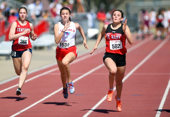 Dell Rapids St. Mary's Ella Heinitz, right, runs in a 100 meter dash during the Dakota Relays on Saturday, May 1, 2021, at Howard Wood Field in Sioux Falls.