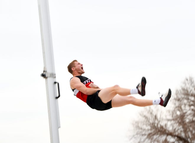 "Jaden Peters from Wagner yells in victory as he falls on the other side of a 15' 6"" pole vault during the Dakota Relays on Friday, April 30, 2021, at Howard Wood Field in Sioux Falls."