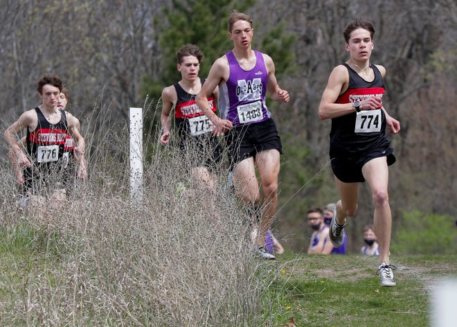 Stevens Point's  Jake Bourget (774) runs the course during a WIAA Division 1 sectional Saturday at Standing Rocks Park near Stevens Point.