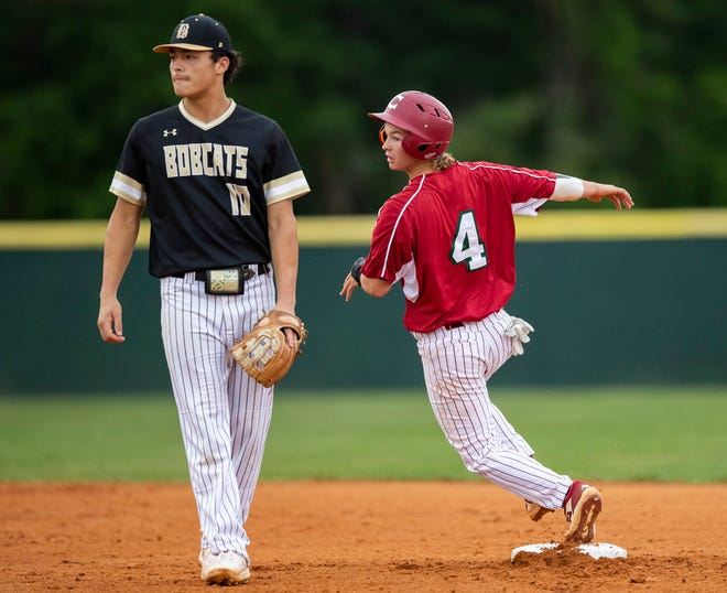 Chiles' Bryce Long (4) keeps his eye on the ball as he rounds second base. Chiles won the District 2-6A championship trophy after shutting out Buchholz 8-0 on Friday.