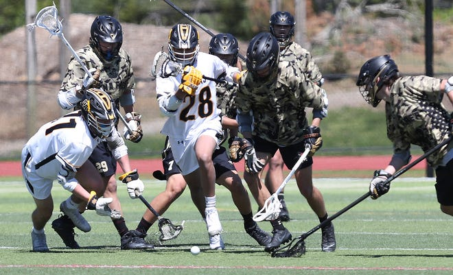 Iona and Saint Anthony's battle for a ground ball during lacrosse action at Iona Prep in New Rochelle May 1, 2021. Saint Anthony's won the game 14-8.