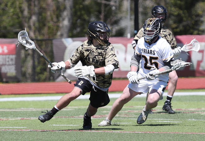 Iona's Ben Falch (2) tries to get around Saint Anthony's Jack Poozio (25) during lacrosse action at Iona Prep in New Rochelle on Saturday. Saint Anthony's won the game 14-8.
