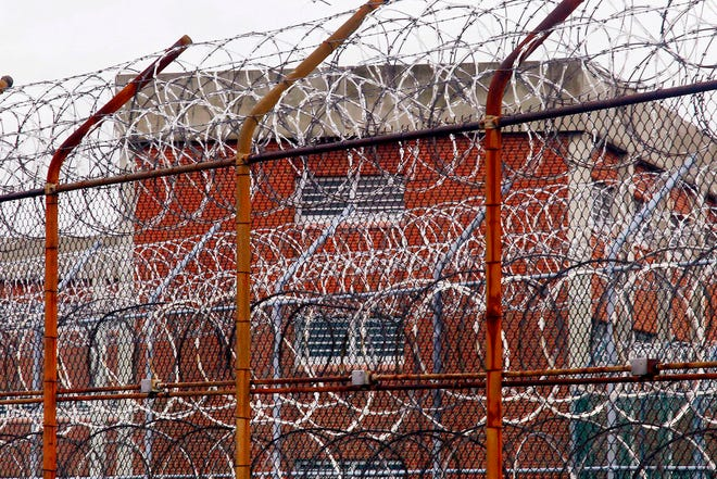 A security fence surrounds inmate housing.