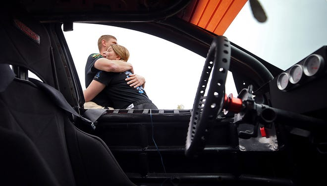Kenny Betts Jr. wraps his 13-year-old daughter Harmony up in a hug before her second compact division race Saturday at Barberton Speedway in Norton. Two weeks ago, Harmony became the first driver in a new division that is intended for beginner and younger drivers.