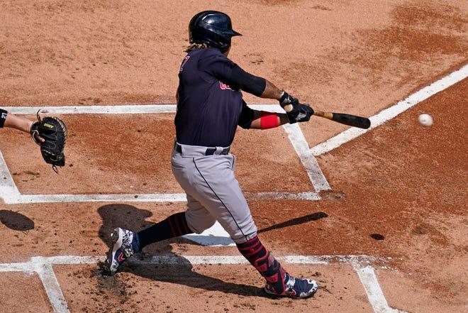 Cleveland third baseman Jose Ramirez has been swinging a hot bat recently. [Nam Y. Huh/Associated Press]