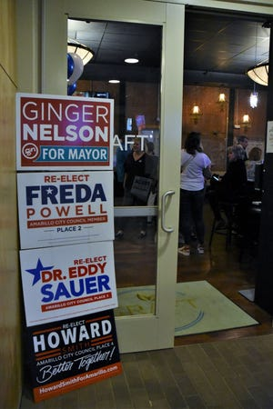 Campaign signs of the incumbent candidates for the city of Amarillo are stacked on top of each other at the front entrance of an election watch party Saturday, May 1 at the Craft Cocktail Lounge in downtown Amarillo.