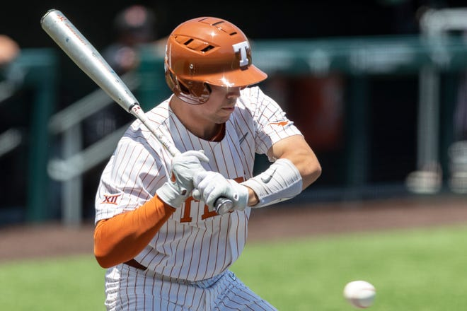 Texas freshman Silas Ardoin strikes out looking in the continuation of a baseball game in Austin on Sunday. Texas Tech earned a 5-3 win in a game that started on Saturday but was delayed by weather.