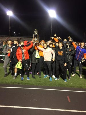 The Ashland High boys track and field team poses for a picture after winning the Marion Night Invitational on Friday.