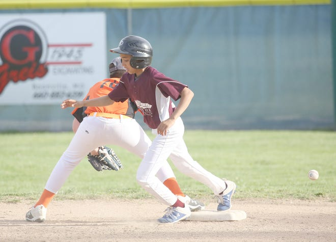 Einspahr Construction's Karson Elbert races to the bag at second after hitting a stand up double in the first inning Saturday against Rt. B Cafe in Cal Ripken Major at the Cooper County Baseball Assocation ballfield.