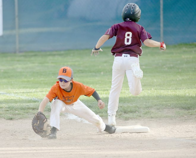 Einspahr Construction's Isiah Kennedy attempts to beat out a play at first against Rt. B Cafe in Cal Ripken Major Saturday at the Cooper County Baseball Association Ballfield at Harley park.