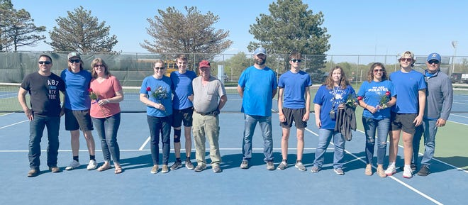 Four senior members of the Boonville Pirates tennis team and their parents were recognized prior to the match Thursday against the Mexico Bulldogs at the high school tennis courts. The Pirates fell to Mexico by a score of 9-0.