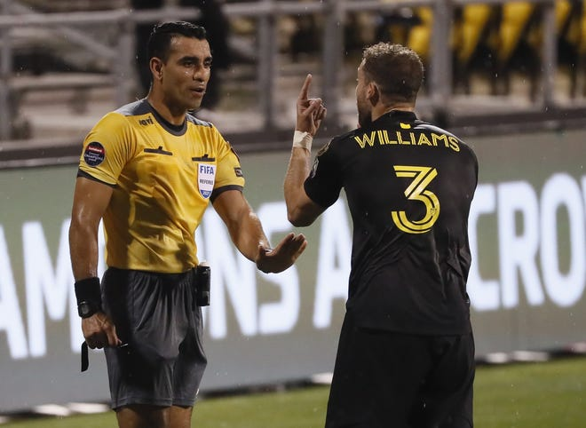 The Crew's Josh Williams reacts to a foul and argues with referee Juan Calderon during a CONCOCAF Champions League quarterfinal on Wednesday. Calderon called 19 fouls and one yellow card on Monterrey but six fouls and two yellows on the Crew.
