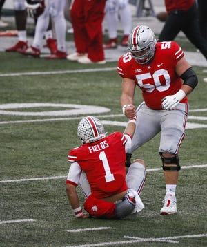 Josh Myers, here helping quarterback Justin Fields get off the turf after a sack, could start in Green Bay.