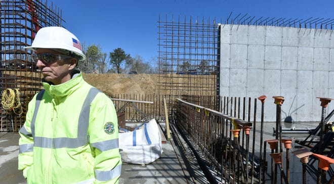 Orleans Building and Facilities Manager Ron Collins looks over the work on the town's new wastewater treatment plant, which is under construction. After years of trying to secure funding for wastewater efforts, Cape towns have found ways to finance projects and move them forward.