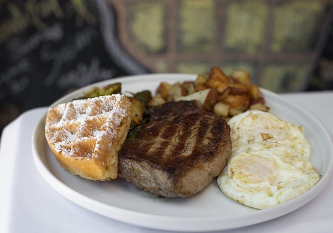 Steak and eggs at What the Waffle in the King-Lincoln District.