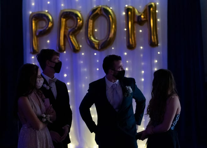 Schoolsare taking a varied approach to the prom. Some are moving forward, with limits. Others have canceled it, steering students to other senior events.