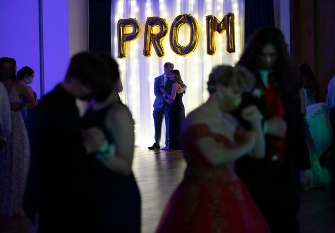 Students take photos and dance during the Hilliard Darby High School prom at The Exchange at Bridge Park in Dublin on Saturday.