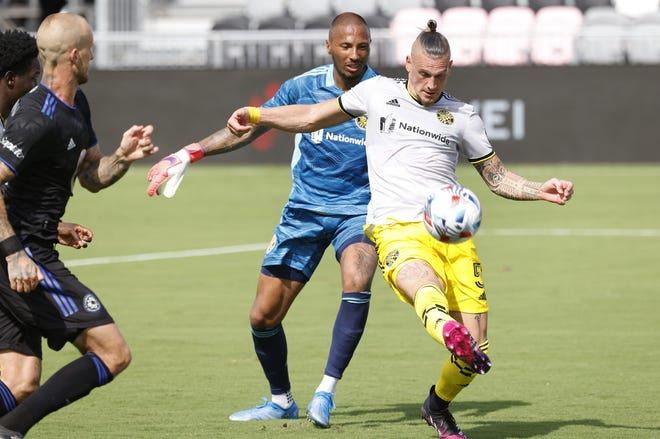 Crew defender Vito Wormgoor and goalkeeper Eloy Room defend the goal against CF Montreal on Saturday. Wormgoor was playing his first game since July.