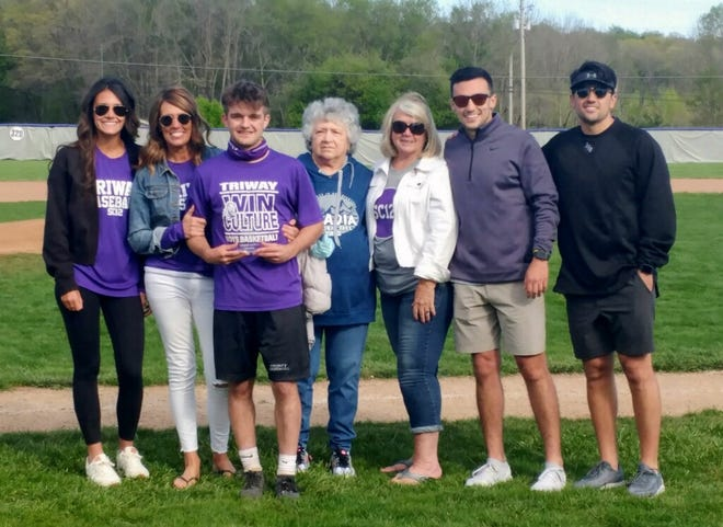 Triway senior Colton Snyder stands with the Carmichael family after receiving the Sean Carmichael Memorial Scholarship. Pictured (left to right): Zoe Carmichael, Angie Carmichael, Colton Snyder, Sharon Carmichael, Peg Bevington, Parker Carmichael, Derek Carmichael.