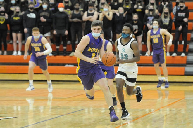 Blissfield senior Ty Wyman (2) pushes the ball up the floor during the Royals' Division 2 regional semifinal game against Romulus Summit Academy on March 30 at Tecumseh.