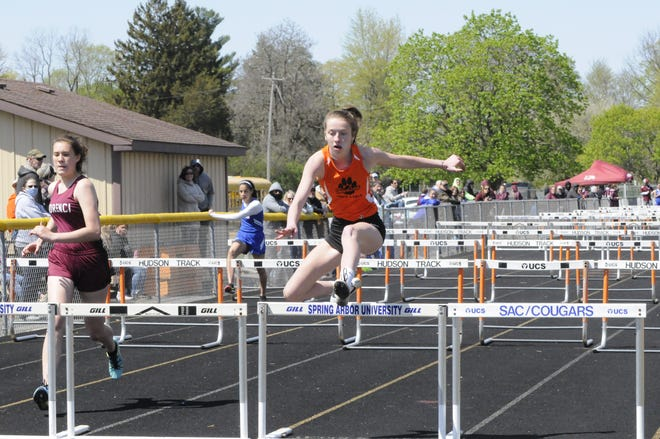 Hudson junior Teal Head, center, clears a hurdle during the 4x100 shuttle hurdle event at Saturday's Hudson Booster Invitational. Head, along with Logan Parks, Paige Clark and Kayden Chrisman-Rogers, won the event in 1:20.2 to help the Tiger girls squad take top honors.