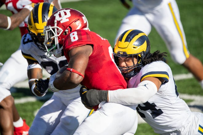 Nov 7, 2020; Bloomington, Indiana, USA; Michigan Wolverines linebacker Cameron McGrone (44) tackles Indiana Hoosiers running back Stevie Scott III (8) during the first quarter of the game against the Michigan Wolverines at Memorial Stadium.