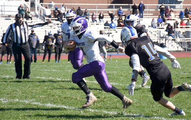 Little Falls Mountie Cole Cleary heads up the field Saturday after catching a pass from Rikki Smith for a touchdown in overtime at Mt. Markham.