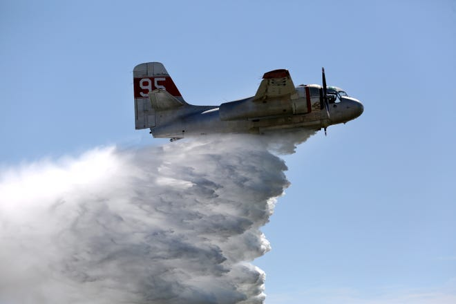 Bill Garrison did two water demonstrations with his Tanker 95 during Hutchinson Regional Airport's Fly-In and Open House Saturday. Tanker 95 is a converted Grumman S-2 that has a 1,000-gallon water tank, that is used to fight wildfires in Kansas and nearby states through the Kansas Forest Service.