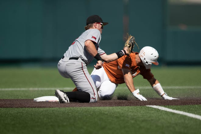 Texas Tech's Jace Jung applies a tag during a Big 12 Conference game Sunday, May 2, 2021, against No. 3 Texas at UFCU Disch-Falk Field in Austin.