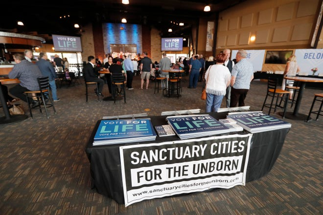People wait for the early at an anti-abortion election watch party at Trinity Church in Lubbock, TX, Saturday May 1,2021.