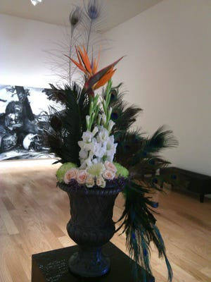An interpretation of the current exhibit at the 2018 Art in Bloom by Tisha Schiavitti, a member of the Laurelwood Garden Club.