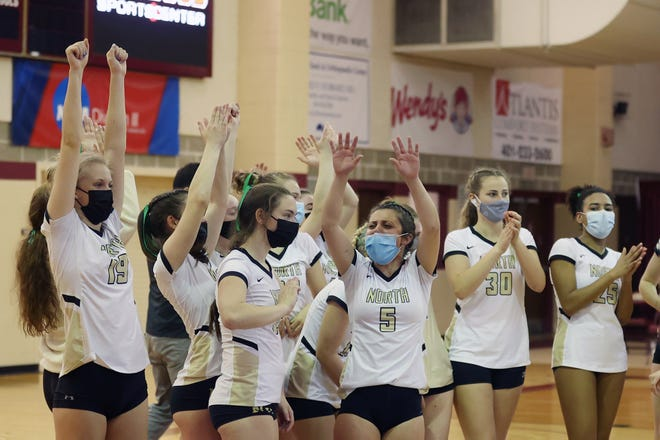 St. Raphael Academy celebrates winning the Division III girls volleyball title Saturday night, beating Rogers, 3-1.