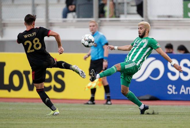Energy FC defender Rob Coronado (right) goes to play a ball against Atlanta United 2 midfielder Tyler Wolff (28) on Saturday at Taft Stadium.