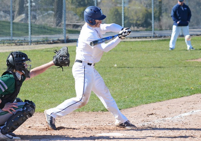 Petoskey's Ian Piehl likes the high heat coming across the plate during the opener against TC West on Friday.
