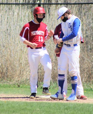 Portsmouth's Max Lalime chats with Oyster River first baseman Andy Carlson after one of Lalime's four singles during Saturday's game at Portsmouth High School.